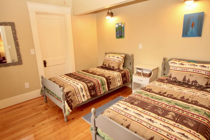 Twin Bedroom with 3 big windows and beautiful wooded view.
