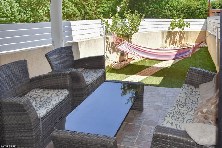 Rear lounge area with garden and hammock