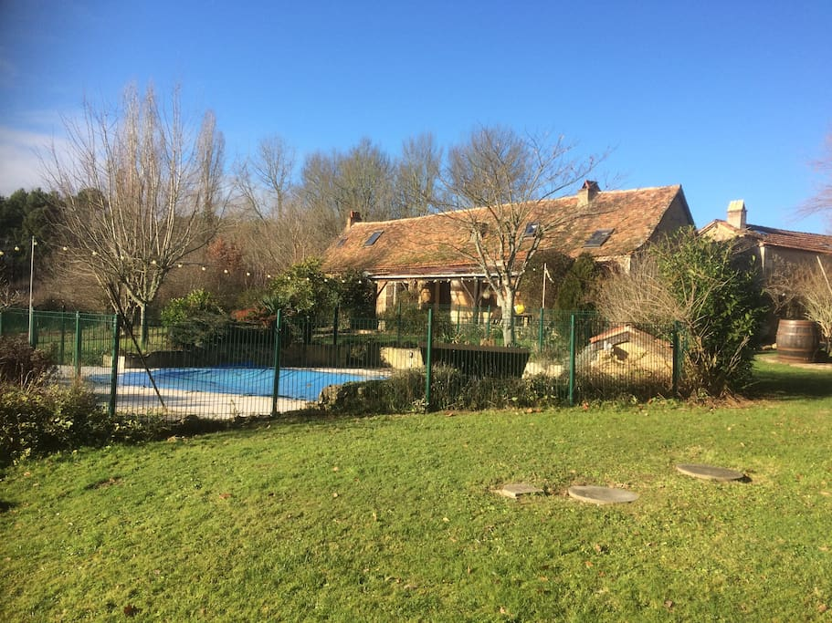 Back garden and swimming pool,fully surrounded by the french country side very private and beautiful
