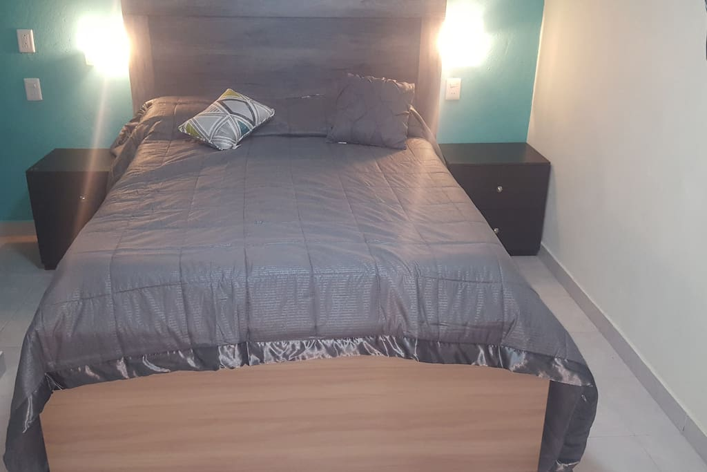 Double bed with a pair of lights to read