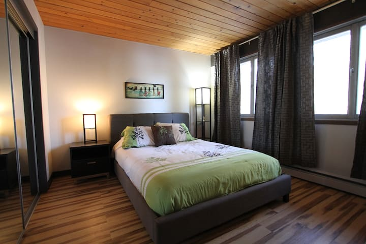 Main level bedroom with queen quality mattress, great view of the water and backyard we call this one the bird room.
