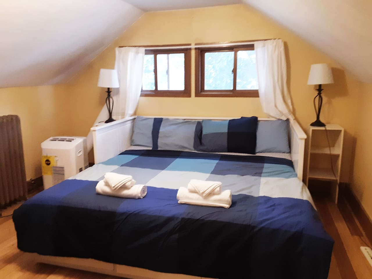 In Big Ole Red Guest House third floor,  Gold King  sleeps 2+. The queen bed  sleeps 2. Up a narrow flight from the bathroom,   it is a no frills bed and breakfast. Limited parking is first come first serve with overflow parking is up the street.