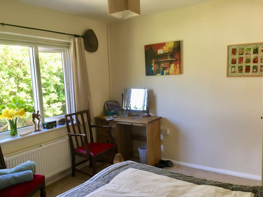 Your bedroom with garden views, hair dryer and desk for you to use with tourist information and a helpful house guide.