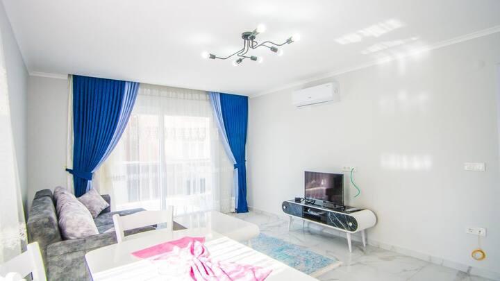 Уютная квартира в 150 метрах от  моря в Махмутларе