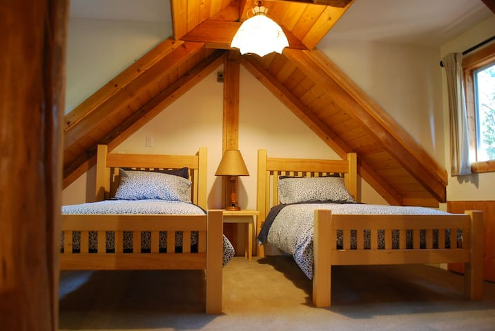 Loft bedroom with twin beds.