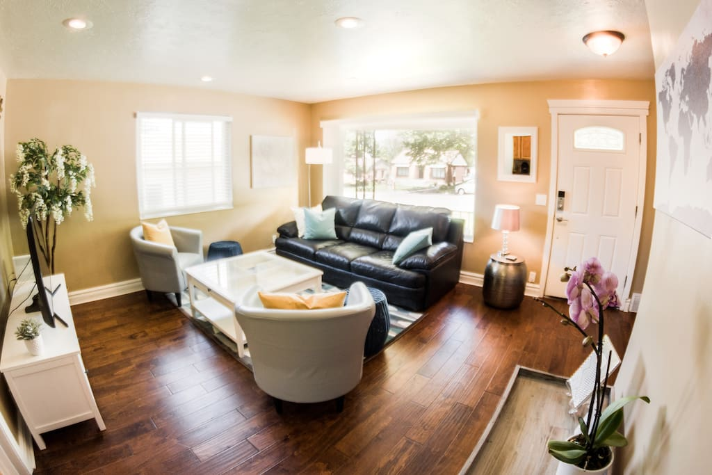 Bright open living room with plenty of seating and a flat screen TV