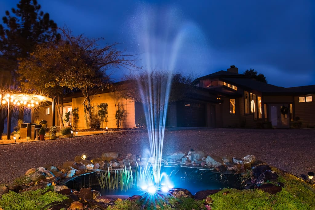 Fountain at night at entrance to room