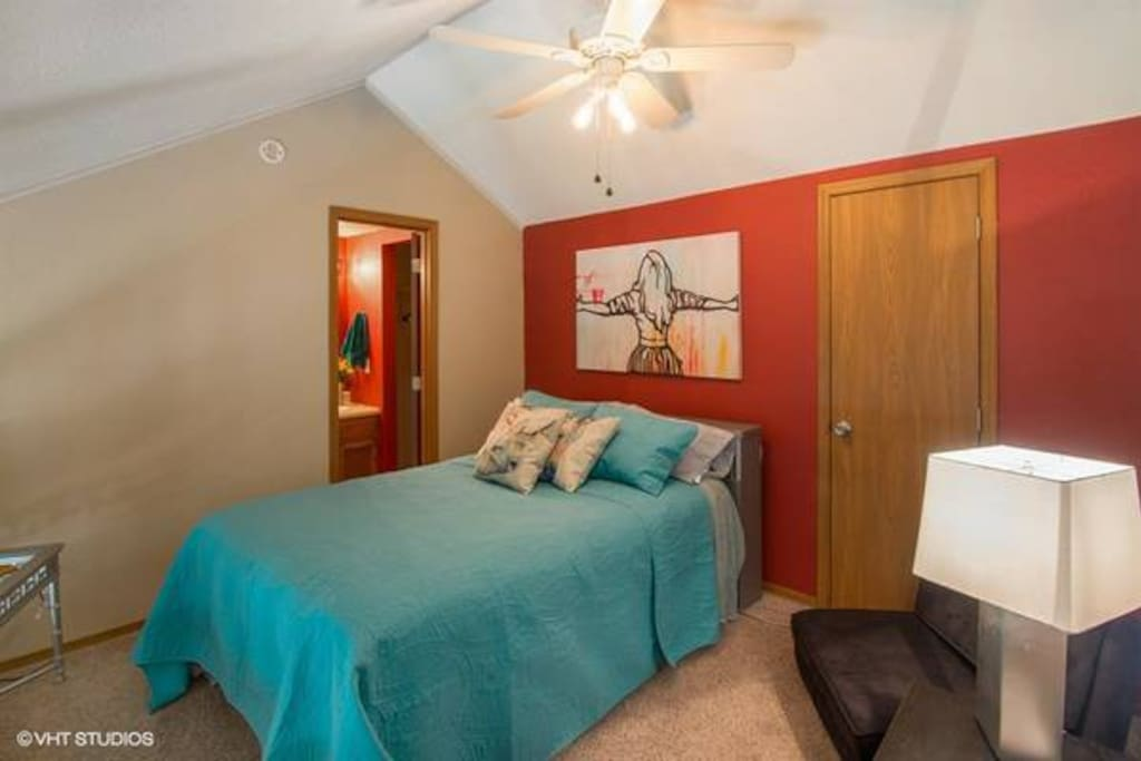 Full size bed with attached bathroom in loft
