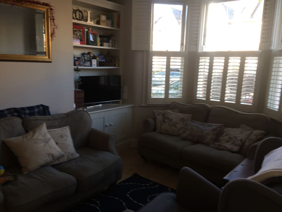 Cosy living room with two 2seater sofas, armchair and tv/internet access.