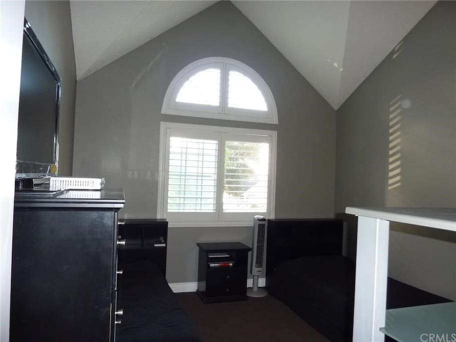 Master bedroom with vaulted ceiling