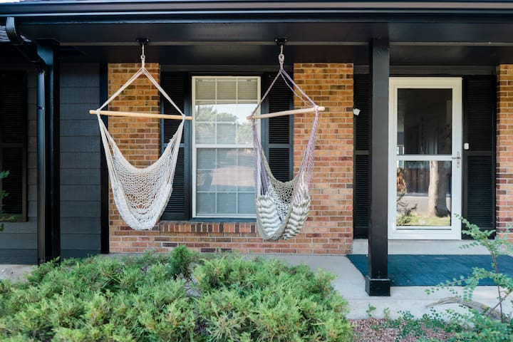 Take a break in the hammock swings on the covered front porch.