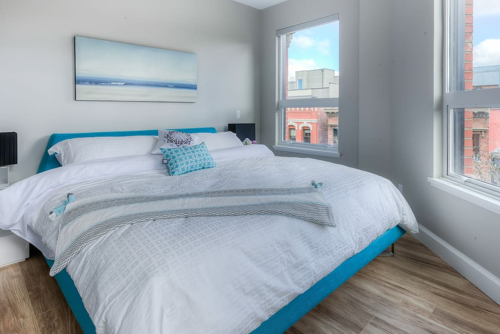Super comfy King bed with gorgeous city views out of 3 windows, all with blinds.