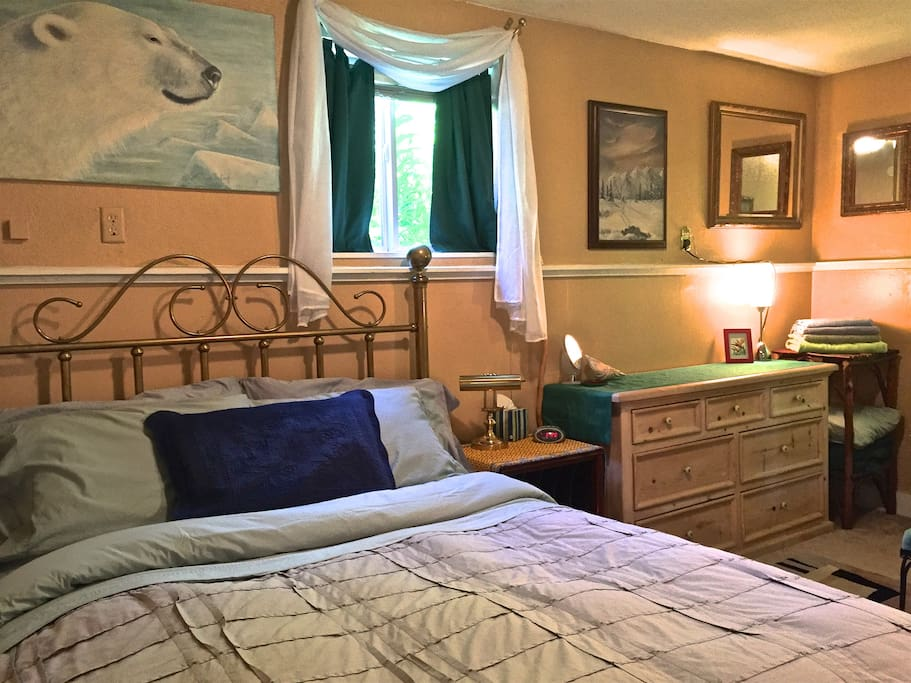 "The ""oh so comfortable"" queen size bed with egyptian Cotton linens and Blackout curtains for ""The Midnight Sun""."