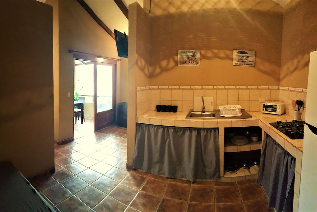 Fully equipped kitchen and the view to your balcony