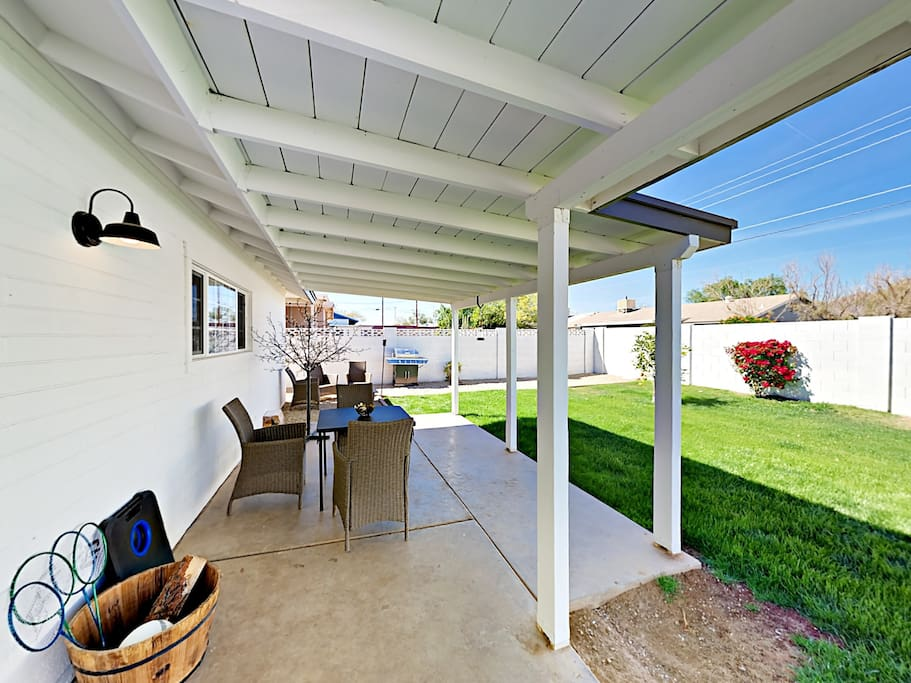 The lush green backyard is fully fenced and perfect for entertaining.