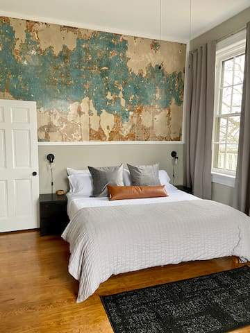 This home has been completely restored over the last two years with unique architectural details preserved- like exposed brick and this distressed wall.