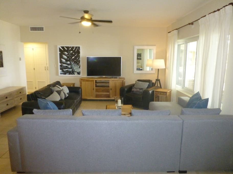 """Living room with new Samsung 55"""" LED """"curved"""" TV"""