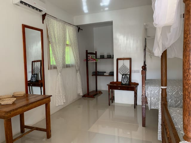 Kipepeo guest twin bedroom
