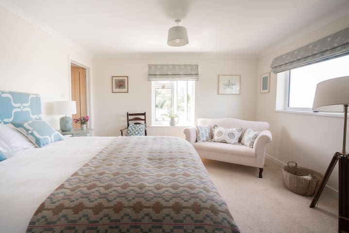 Bedroom 1 is spacious and light with king size bed and wonderful views over Newport Bay.