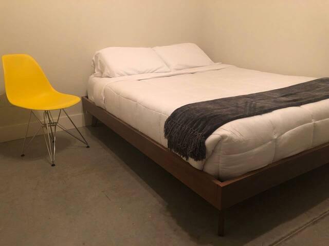 Chic Bedroom in Modern Downtown Smart Loft