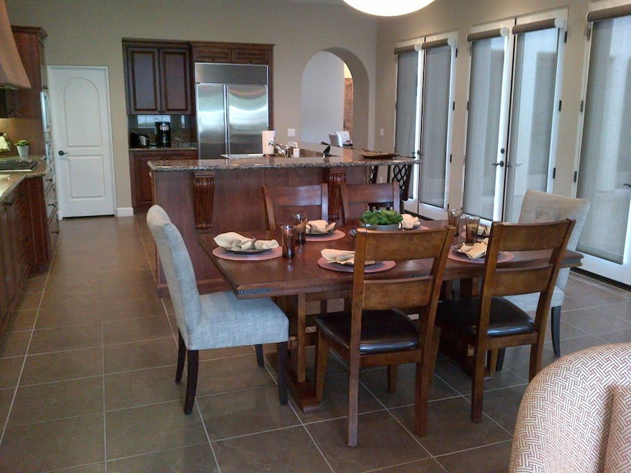 Gourmet kitchen and family dining with spectacular views.