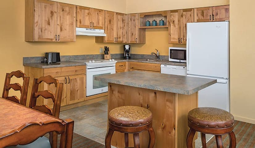 full size kitchen with dinnerware, pots and pans