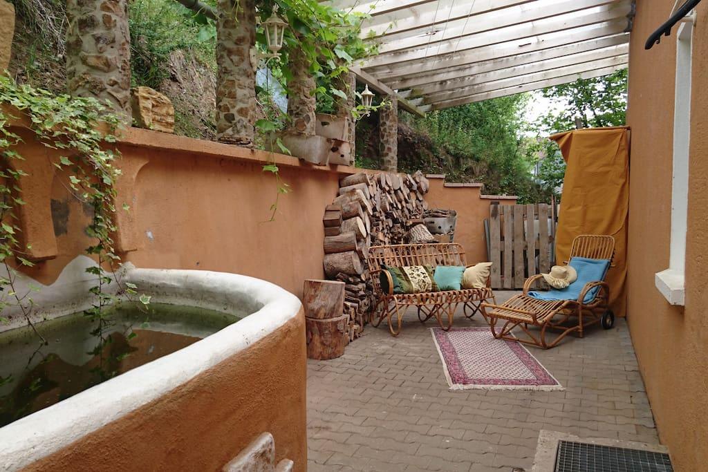 Mediterranean house terrace fireplace garden for Terrace garden meaning
