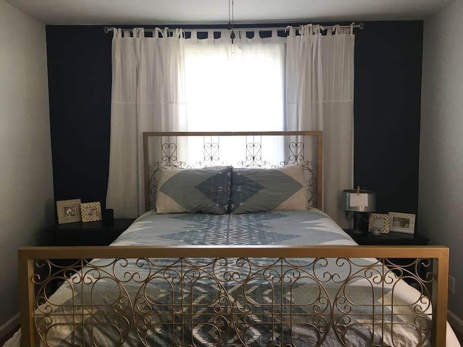 Master bedroom with a cozy queen bed.