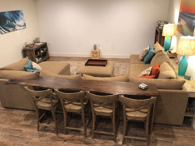 Media room with barstools and pit couch