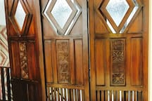 Antique Carved Teakwood Divider with Tinted Glass.