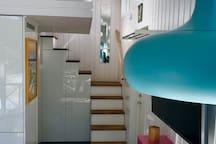 Stairway to mezzanine.