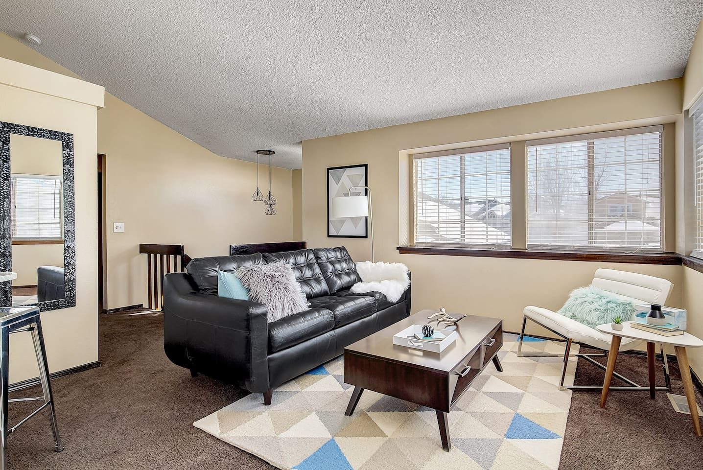 Upstairs living area with a queen pullout sleeper sofa