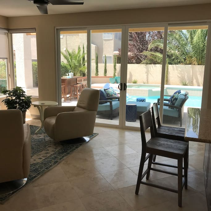 Large doors and windows open to pool