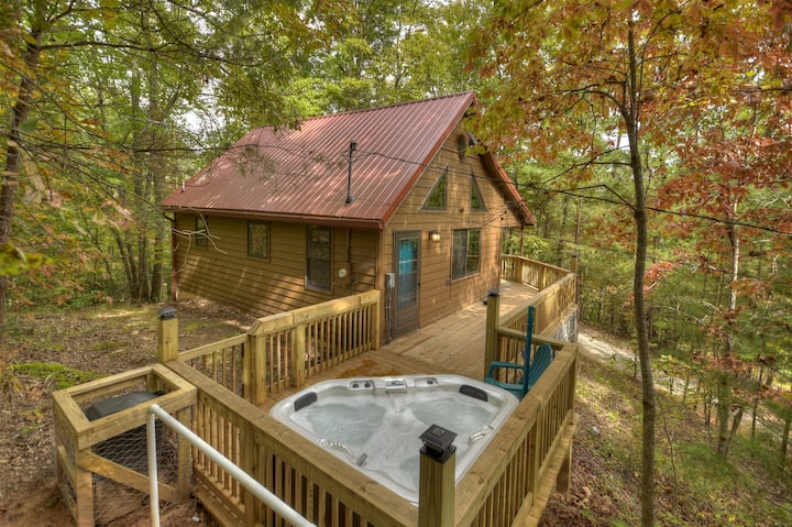 Fox Den Cabin is the perfect mountain cabin that sleeps 4 with a hot tub & fire pit.