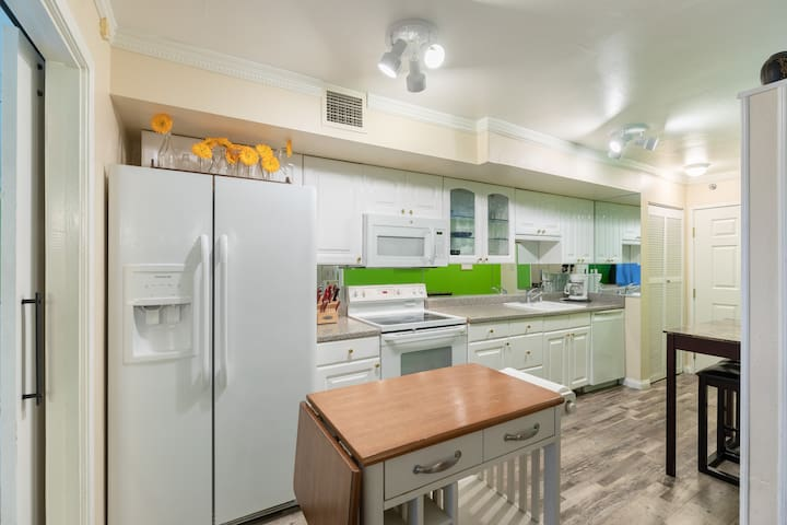 Kitchen with stove/oven, dishwasher, microwave, fridge/freezer, pots/pans, dishes, glasses and utilsels. Fully operational kitchen for preparing meals.