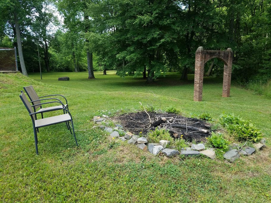 Bonfire circle with view of side yard beyond