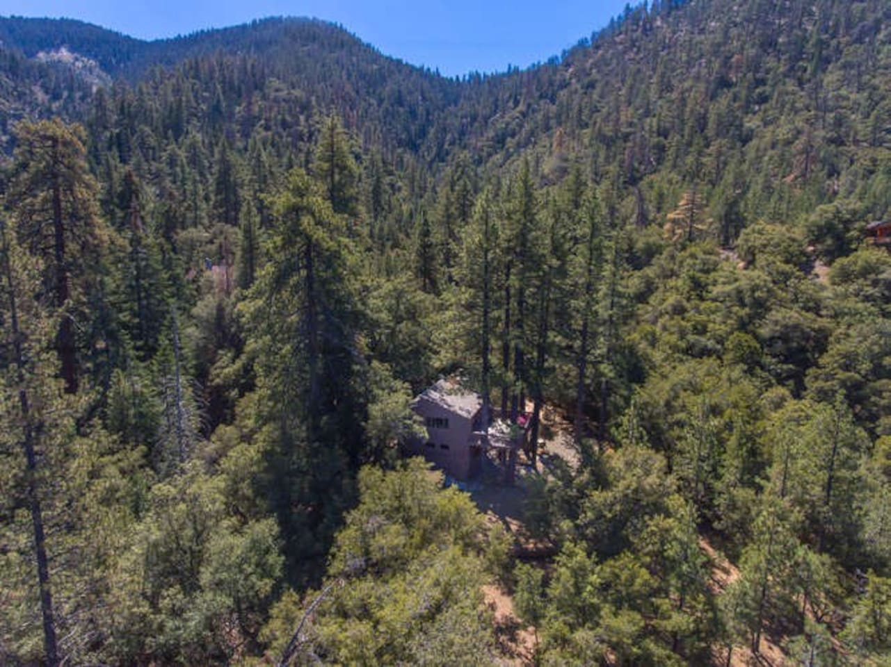 Aerial view of Romance in the Pines. We have a next-door neighbor in a log cabin out of view, but still plenty of privacy!