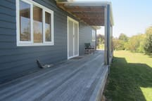 Decking wraps all around the house.There is plenty of parking space for cars and boats.