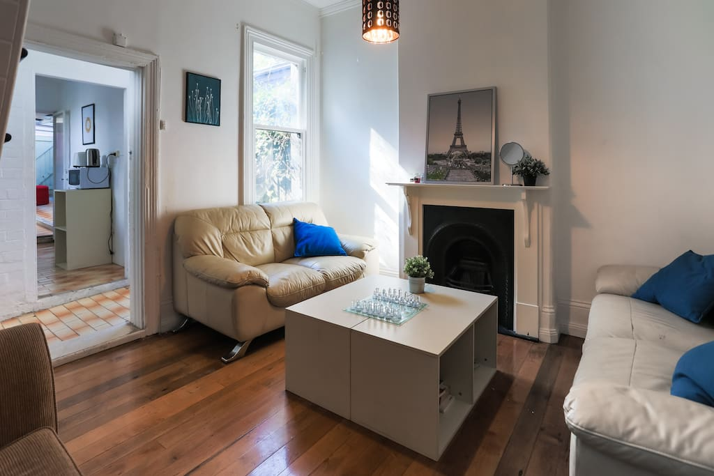 Another view of the spacious living room, with a glimpse of the kitchen.