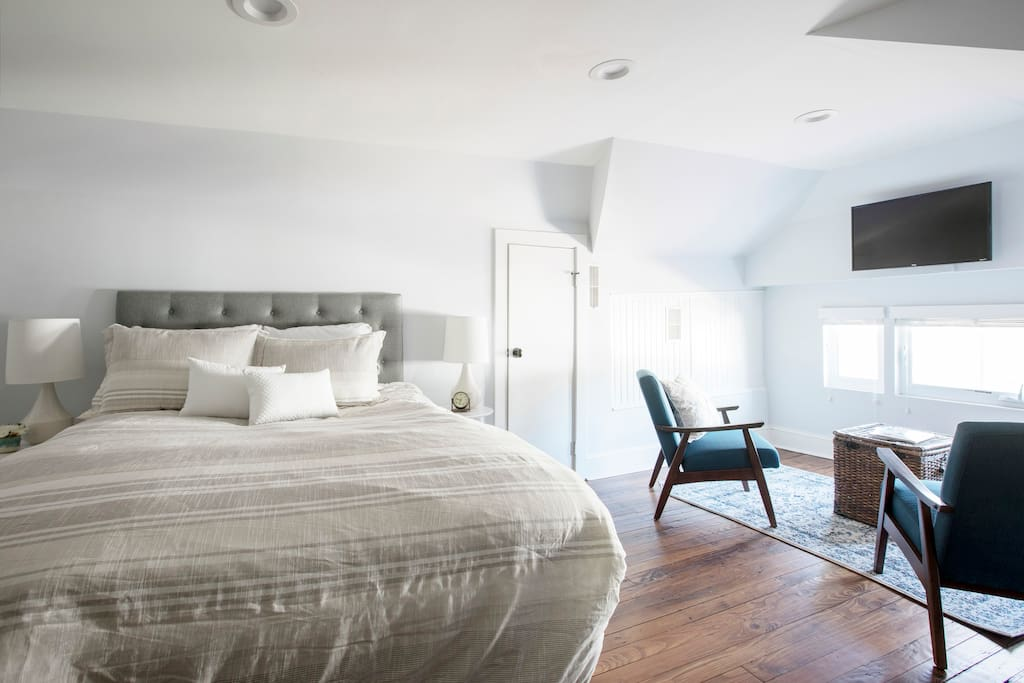 Master Bedroom with a beautiful sitting area overlooking North Tracy Street, Charleston.