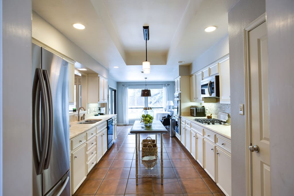 The kitchen has plenty of counter space and quality accessories and appliances to meet your needs during your stay.