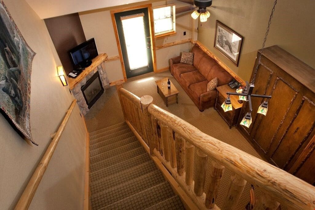 Walk down to staircase into the open-concept living area and relax in the common areas of the suite with your group