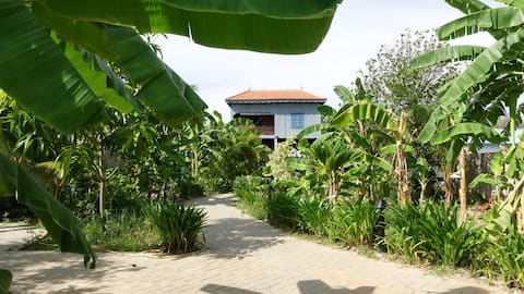 Khmer home outside city. Experince your stay in Village. Explore the city center. Visit interesting places. Welcome you to Phnom Penh City, Cambodia to stay in stand alone wooden khmer home with 2 bed rooms, enjoy khmer food and travelling around...