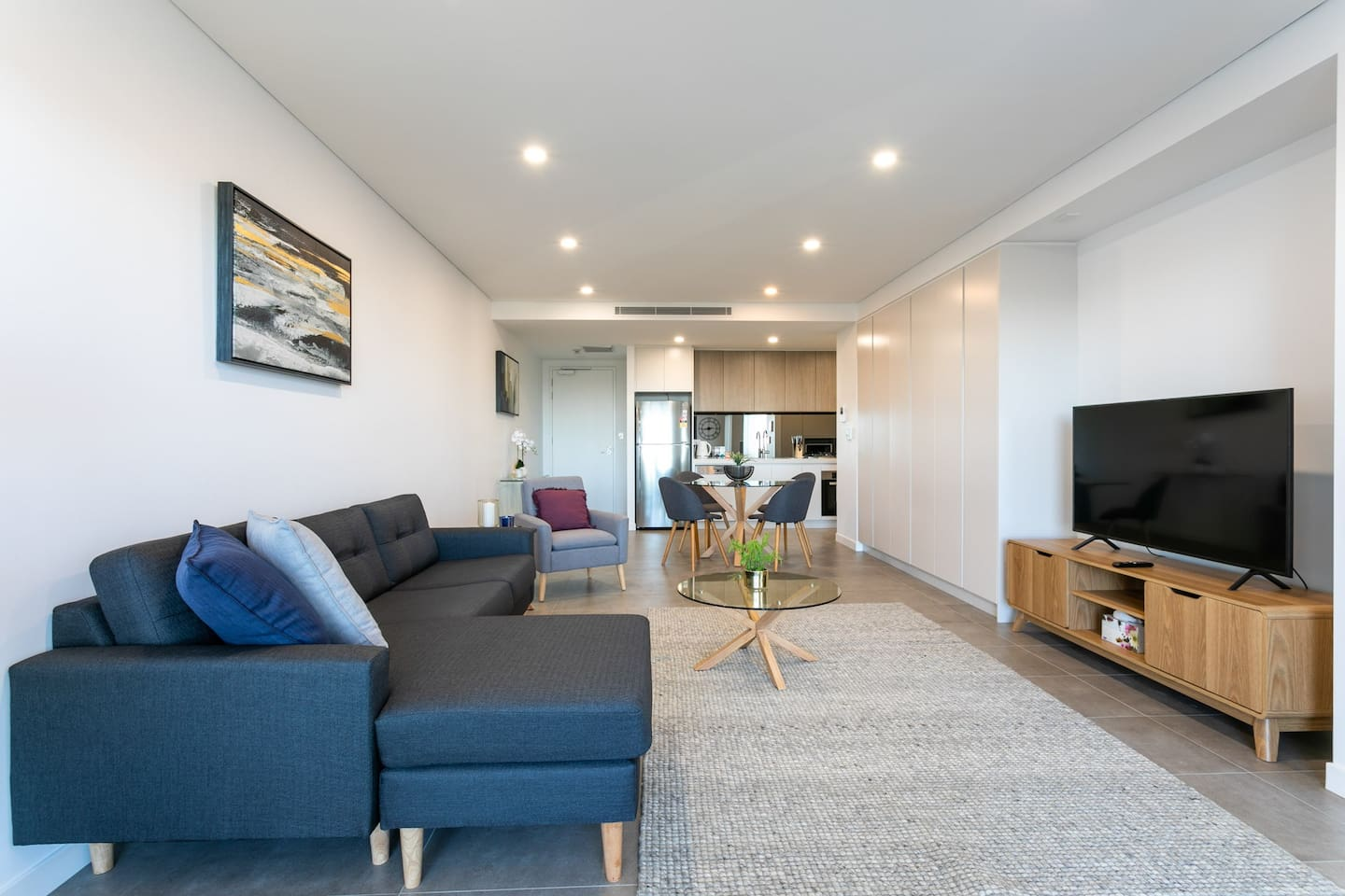 Modern open plan living dining and state of the art kitchen. Modern furnishings for the avid traveler to enjoy.