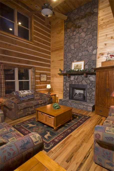 The living room includes a fireplace and cathedral ceilings.