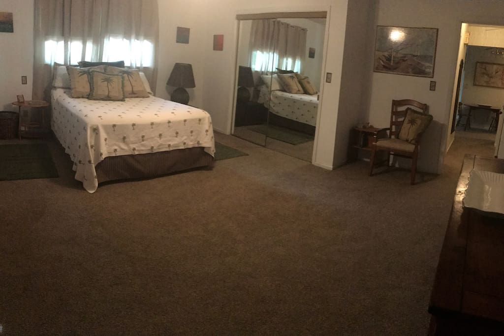 Bedroom has high end mattress large closet and dresser.