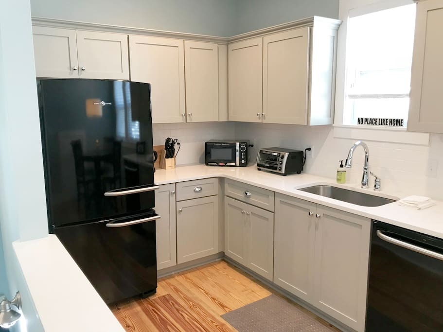 Kitchen appliances: refrigerator, coffee maker, microwave, toaster oven, dishwasher and plates, glasses and service for up to 4 people plus plenty of utensils. Please note there is not an oven or stove top.