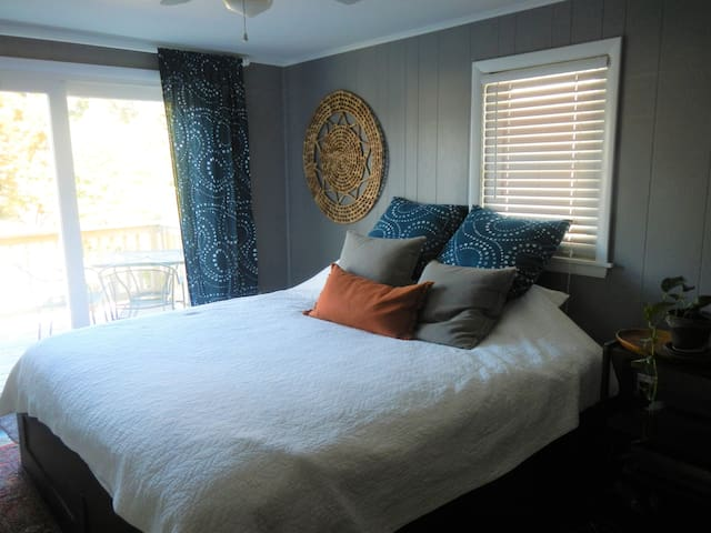 Master with king size bed and sliding door to deck