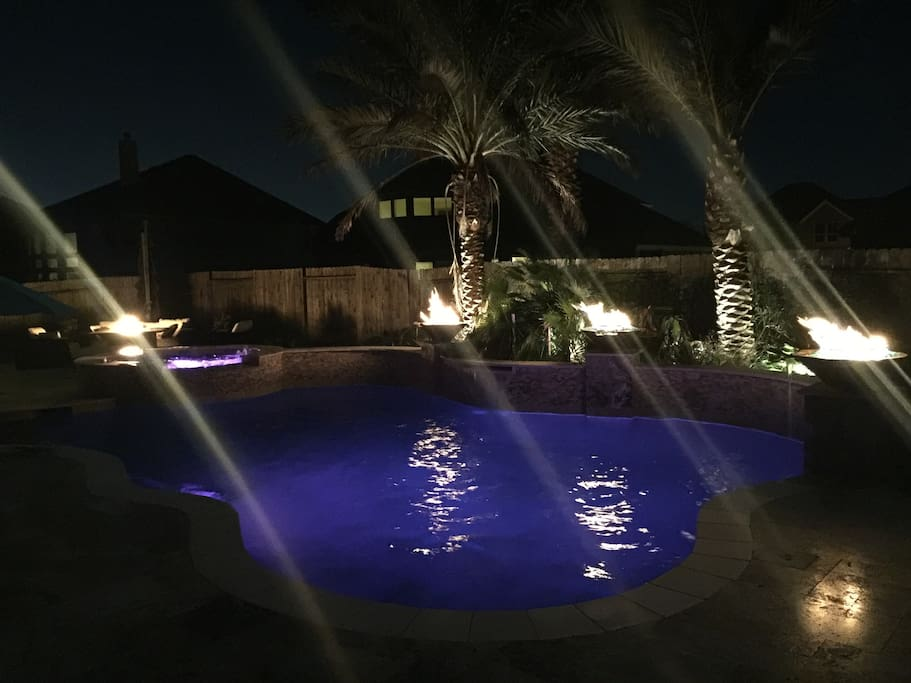 Heated pool! Fire bowls also have a waterfall flowing from them into the pool. Also has built in surround sound around pool