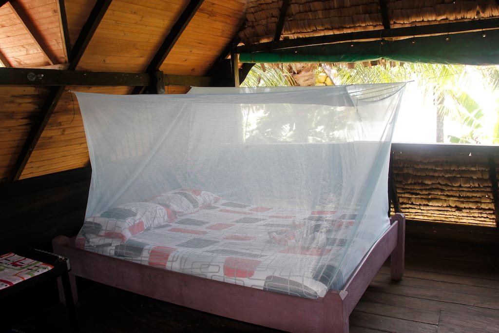 One of the double beds with mosquito net.